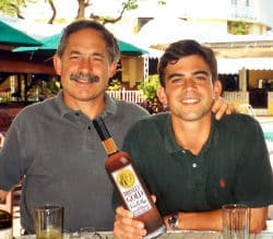 G. Robert and G. Zachary Brinley showing off their rum.