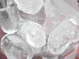 Ice cubes from an automatic ice machine.  Due to their size and shape, they melt a bit quicker than the ice from your refrigerator.